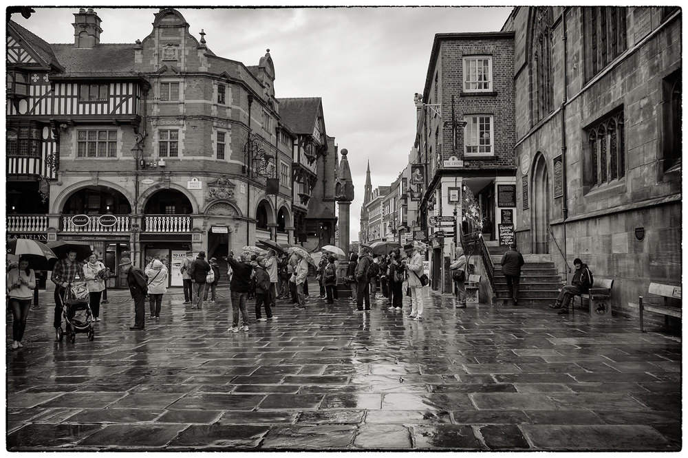 Tourists not put off by the weather at The Cross in Chester.