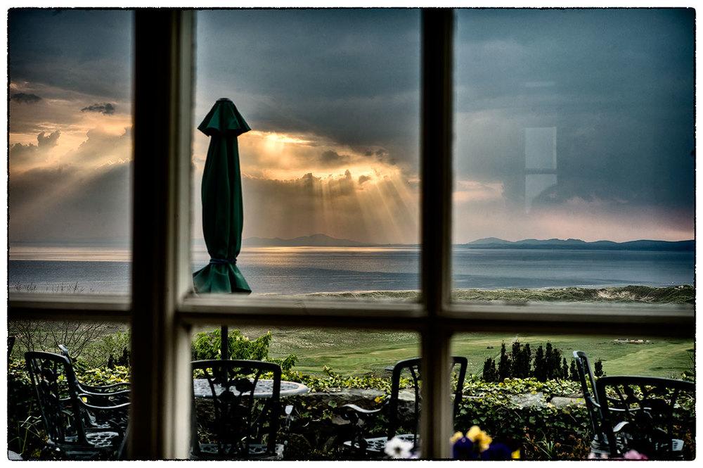 Sunsetting through the restaurant window, memories of Harlech.