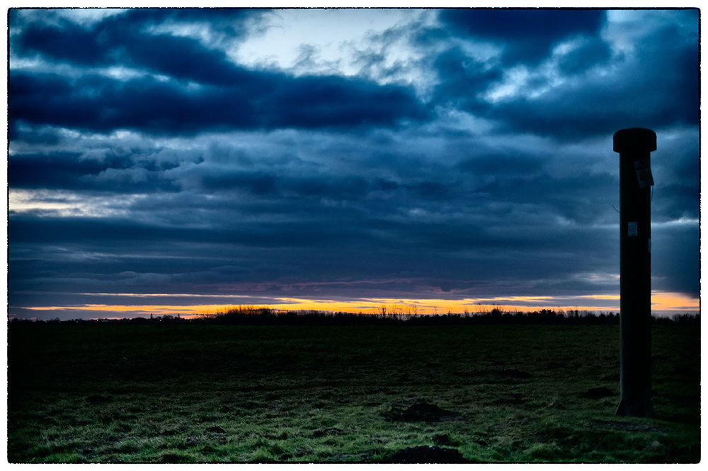 Dog walking just before sunrise in Alyn Waters.