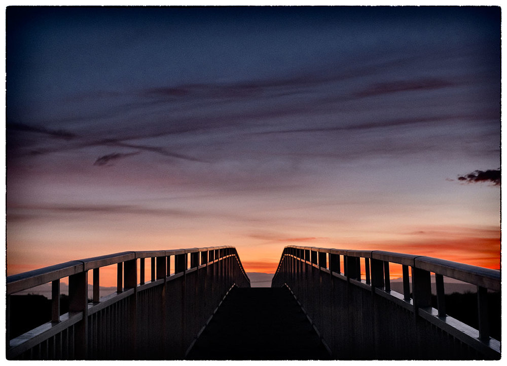 Sunset over a River Dee footbridge off Sealand Road.