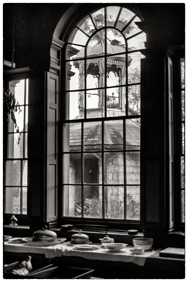 Through the arched window, Erddig .  Love the way the old glass wrinkles what you see through it.