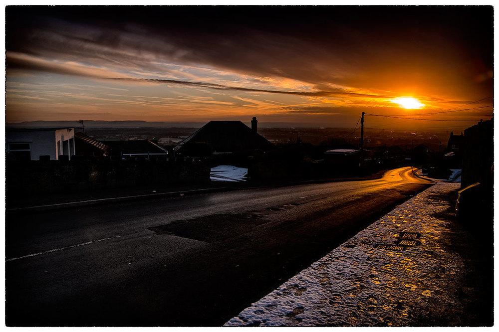 Sun rising over Wrexham as seen from Moss.