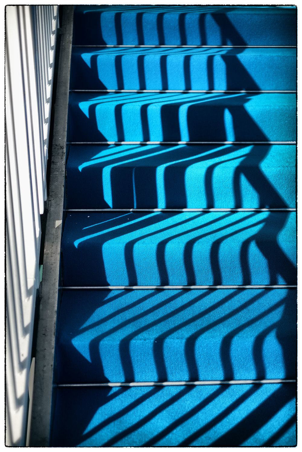 Shadows cast on a staircase.