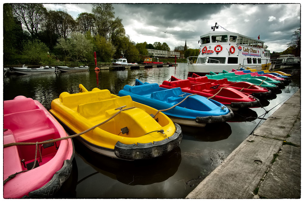 River Dee, Chester.  No takers for the boats today, no matter how bright and colourful they are.