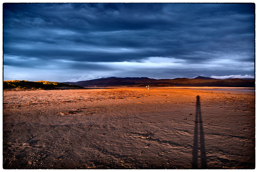 Self portrait in extremely low sun. On the beach, Porthmadog.