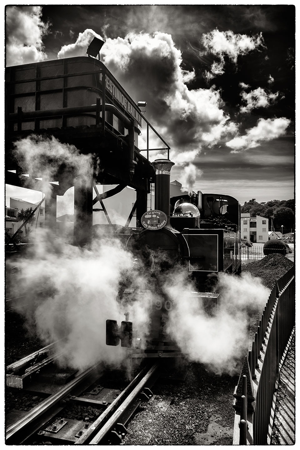 Ready to set off, a mixture of clouds and steam. Ffestiniog railway, Porthmadog.