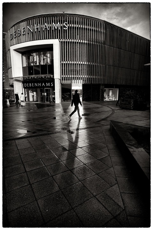 Debenhams, Wrexham and shadow cast by sun's reflection on the building.