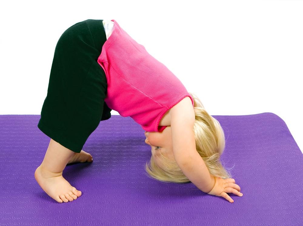 toddler-in-downward-dog-yoga-pose