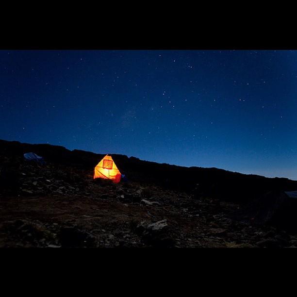 Oforo and Julius burning the midnight oil on Kilimanjaro…
