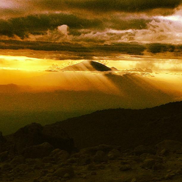 Beautiful sunset over Mt. Meru last night! Off to Barafu camp now and heading to Uhuru Peak tonight! #kilimanjaro #climbing #adventure #bemerrell #sunset @merrelloutside