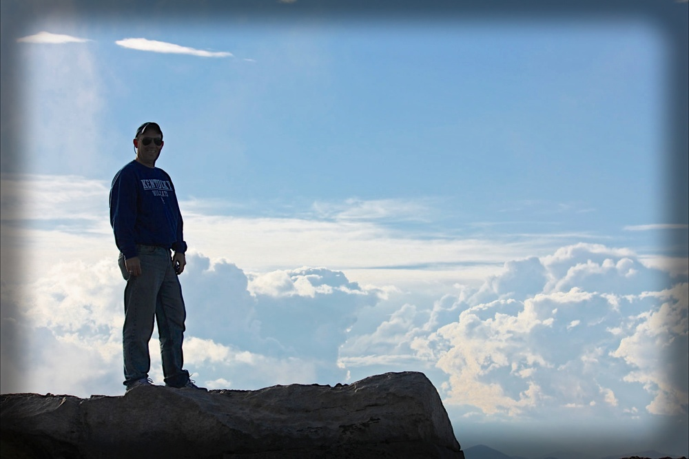 Me with my head in the clouds.  Top of Mt. Evans in Colorado, taken by my good buddy Ward Cully..
