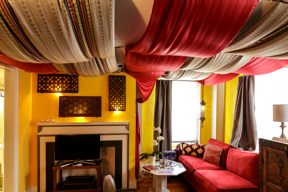 Victor & Mariana-MoroccanSuites Silk Road Room, the fine furnishings include carved Mughal Jali screens, Agra table, draped Turkish silks and pendant lamp-10.jpg