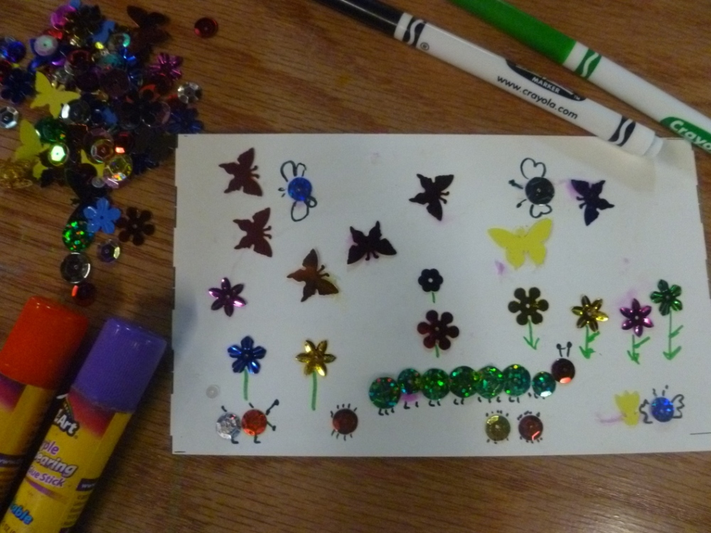 creating a bug and butterfly scene with sequins