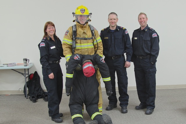 Firefighter Kathi Issler, MP Blaine Calkins, Captain Al Bickford, Firefighter Pat Madden
