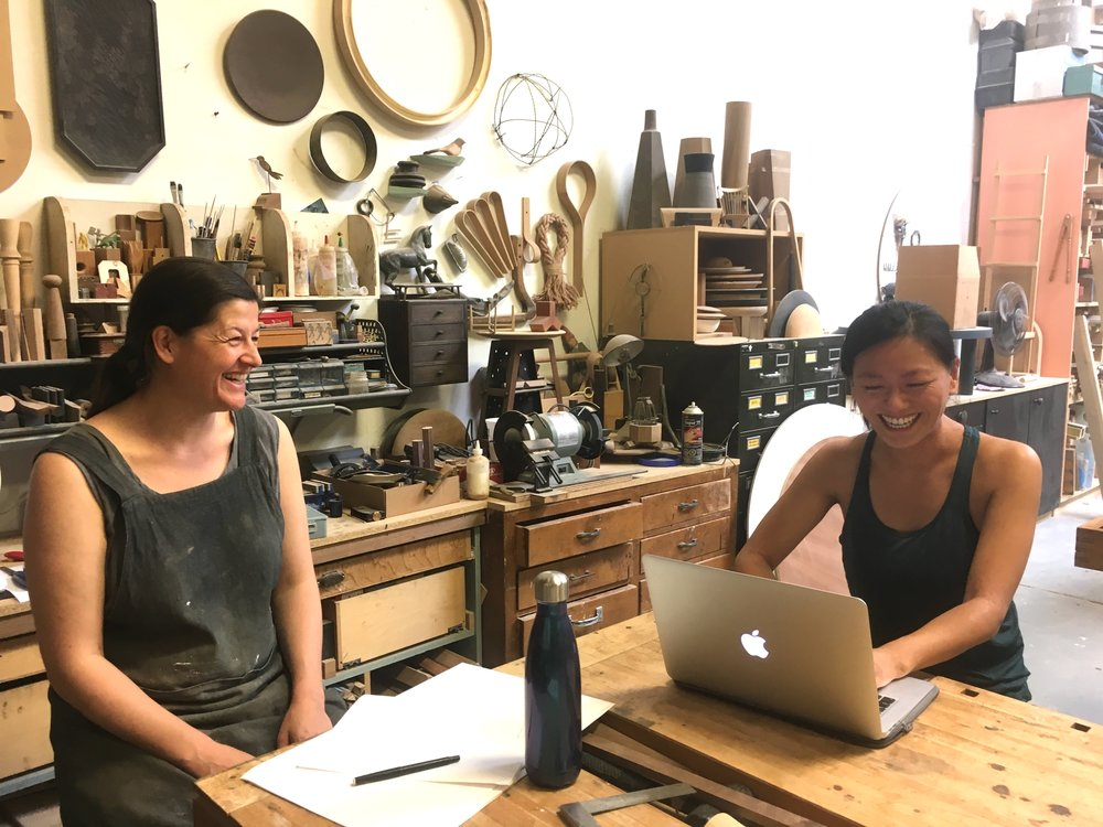 Heidi and Jiajia (right) laughing it up during an interview.