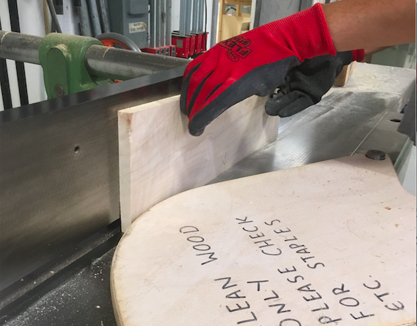 Then the jointer is used to flatten one face of the board and give one side a 90 degree angle to that face.