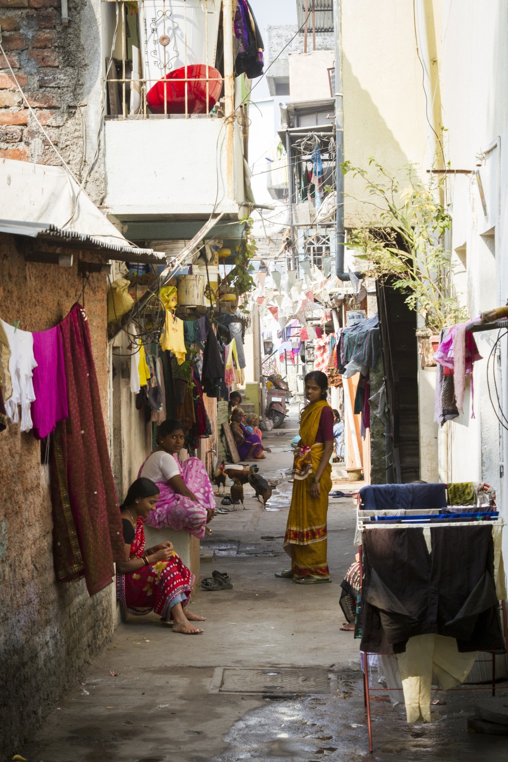 Many people live in similar  narrow, crowded streets and brick buildings like  this part of Wadarvadi.