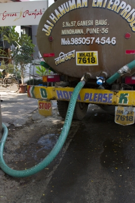 Water trucks, like this one, are used to deliver clean water to areas of Pune that don't have a connection to the municipal pipes. In other cities, like New Delhi, tankers have developed a stake in the local government and discourage building of reservoirs that could take away their business, Aushutosh Mishra said.