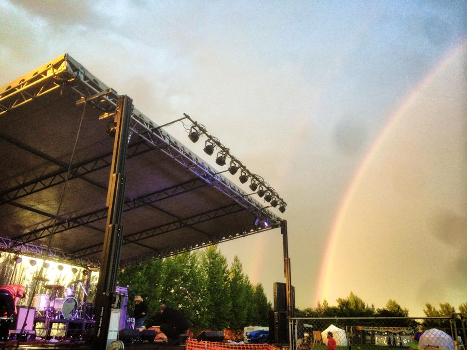 A rainbow emerges from the rain at GCP5.