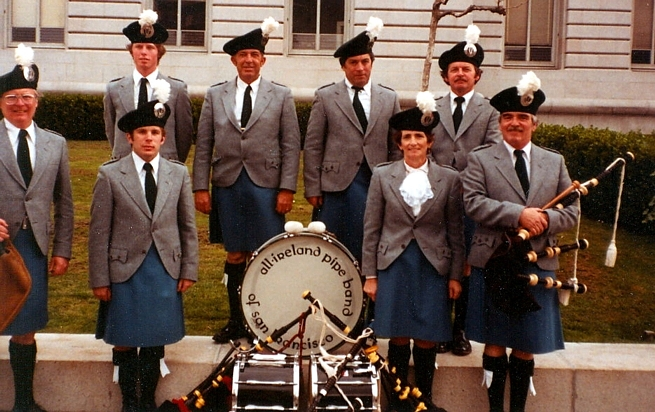 Photo courtesy of Charlie Martin Front Row (Left to Right): Unknown, Unknown, Unknown, John Mahoney (Bass) Front Row (Left to Right): PMaj Bill Driscoll, Charlie Martin, Noreen Brosnan, PSgt Ian Campbell   All Ireland Pipe Band of San Francisco (1989)