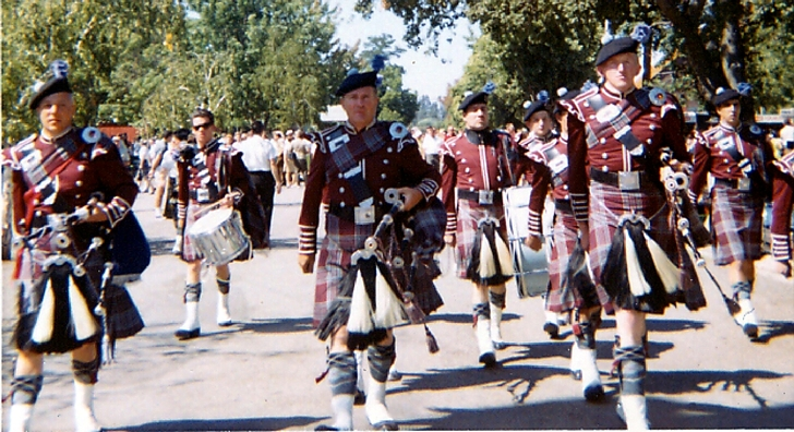 Photo courtesy of Mike Holubar   Lockheed LERA Pipe Band (Approx . 1967) Front rank (left to right) PMaj Tom Kinnear, Stan Patterson, Joe Roberts