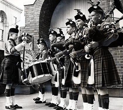 "Reprinted with permission from the SAN FRANCISCO HISTORY CENTER, SAN FRANCISCO PUBLIC LIBRARY San Francisco Boy Scout Pipe Band (1962): ""Troop 90 Highlanders, sponsored by St. Peter's Episcopal Church, 420 29th Ave., will lead a procession of Scouts into the church at 9:30 a.m. tomorrow as part of the Scout Sunday program. Preparing for the ceremony are (from left) leader Robert Thompson, Francis Lee Fong, David Benjamin, Ed Lee Fong, Frank Gee, Mike Krisan, John Rodriguez and George Mason."" SAN FRANCISCO NEWS - CALL BULLETIN 06 Feb 1962"