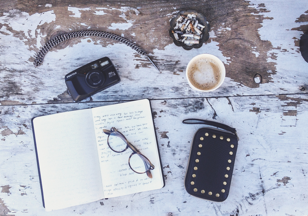 Coffee, cigarettes, Rayban reading glasses, moleskine, Headpeacelove necklace, Cafeteria La Mejor coffee