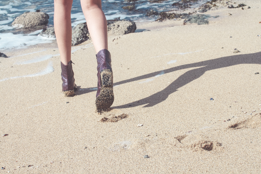 Vintage boots on the beach