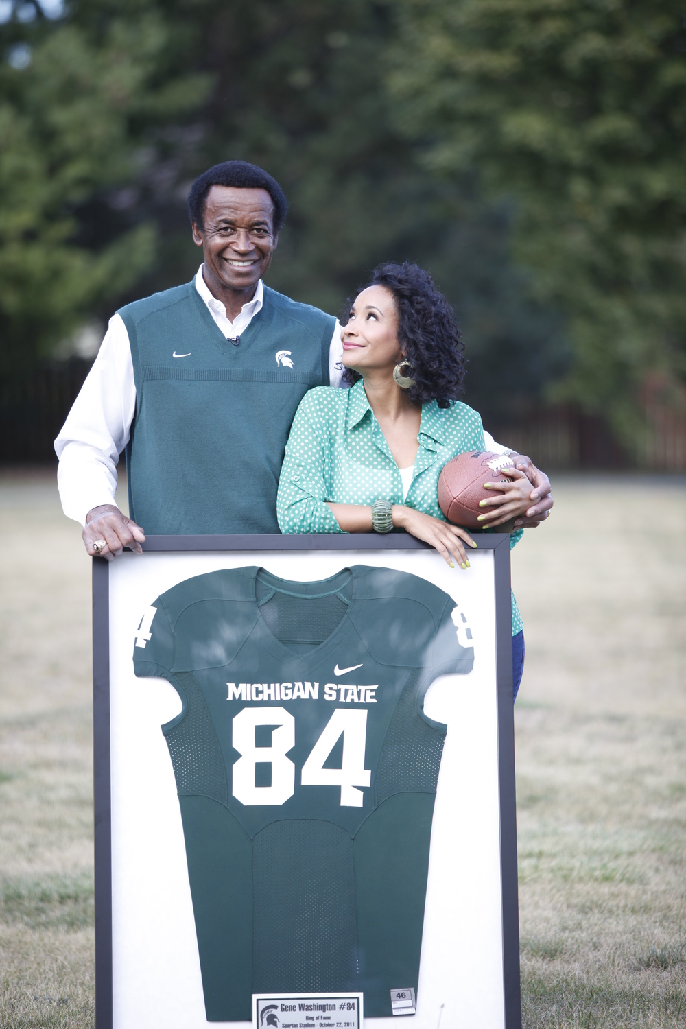 Gene Washington and Maya Washington with Retired Jersey.jpg