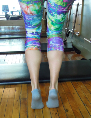 Bent knee calf raise above and straight knee right. Check out the difference in tone in my calf muscles. This alone demonstrates how different muscles are active in each position. Give both a go!