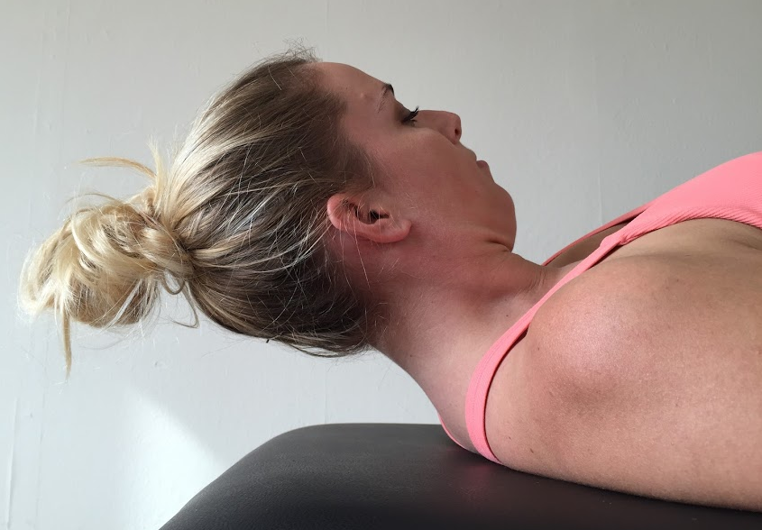 Training cervical flexion endurance with a sustained head lift & hold.