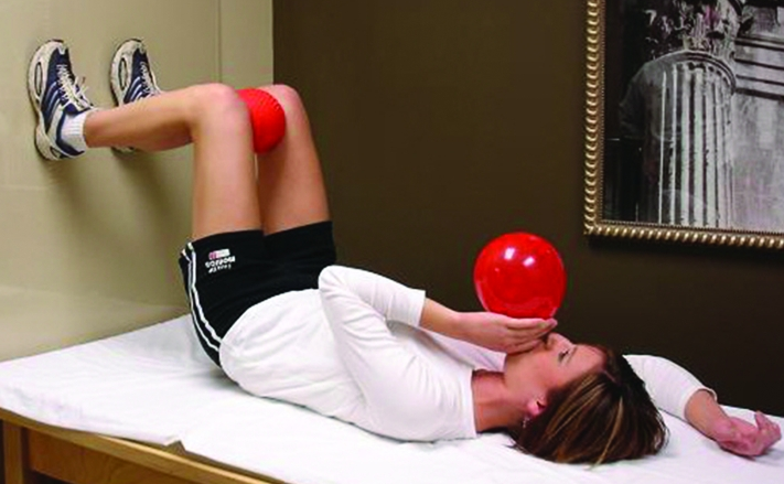 "90/90 bridge with blowing into a balloon. Image credit "" Postural Restoration Institute ""  (used with permission)."