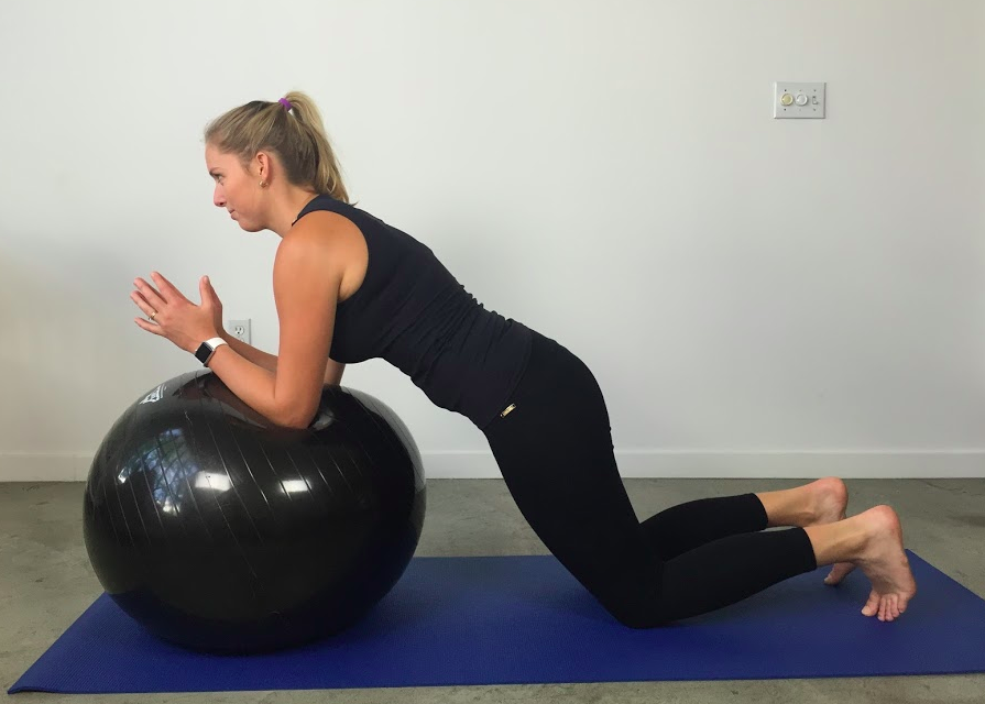 Static forearm plank on ball in kneeling (harder)