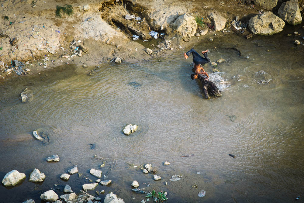 Burmese youth playing in the river.