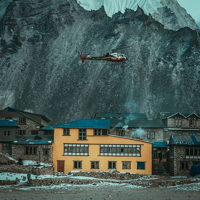 Choppers consistently roar up and down the mountains as you trek up to base camp. They are for trekkers who need to be airlifted out from ⁣ high altitude sickness caused by the lack of oxygen at higher elevations. ⁣ ⁣ To help survive the tough conditions up there, bright coloured teahouses like this yellow one offer a sanctuary to both foreigners and locals. They are places to rest and fuel up with hearty home cooked meals which for me is always a highlight of trip and one of the primary reasons why I travel.⁣ ⁣ What do yo look forward to when travelling? ⁣ ⁣ #ppexpediayellow #passionpassport @passionpassport ⁣ ⁣ -----------------------------------------------------------------------------⁣ #teahouse #nepali #ebc #yellowbuilding #yellow #helicoptor #snow #createexplore #travelnepal #trackingpoints #expedia #explorenepal⁣