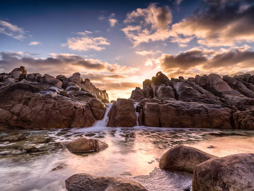 Striking sunset image of wyadup rocks wave pool.