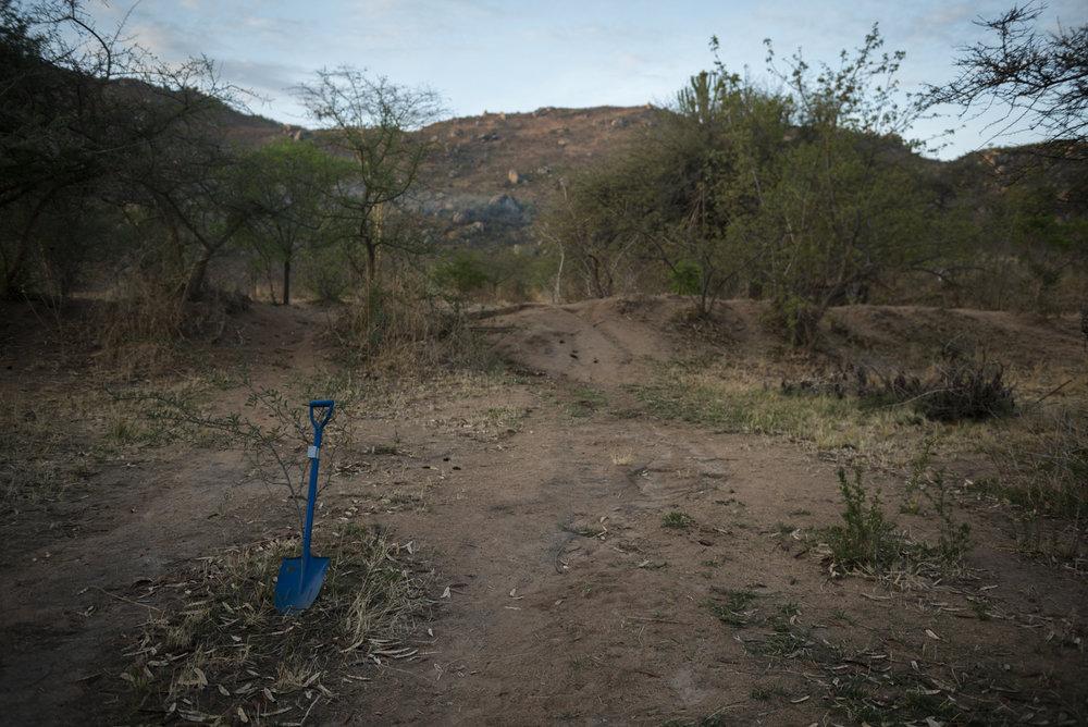 Digging the short drop toilet