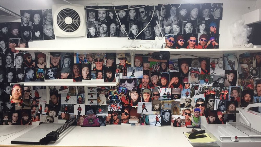 Wall of photos at the end of the work season