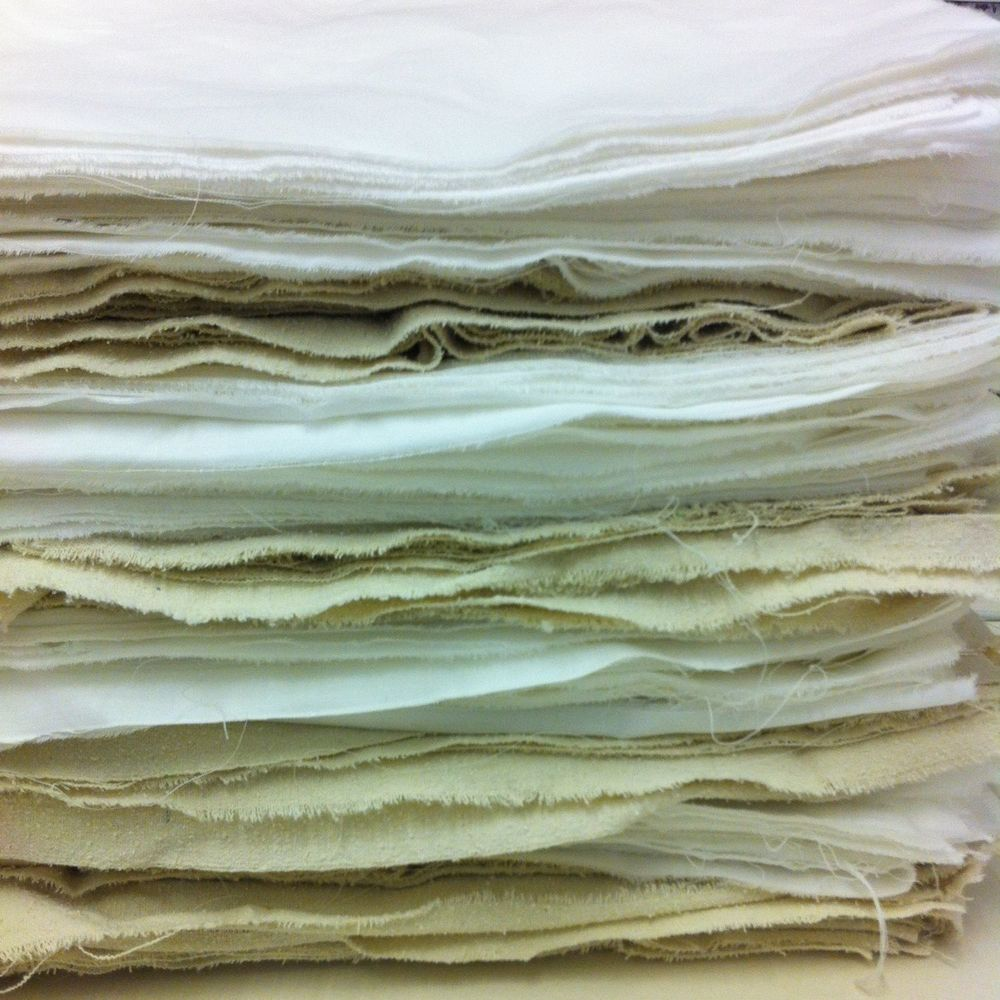 Torn edges - pile of cloth torn to size, waiting its turn