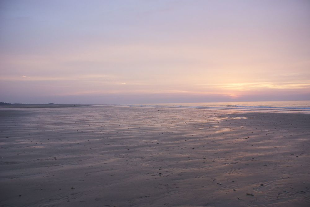all the edges disappearing ... Holkham Bay at sunset with the tide turning (July 2014)