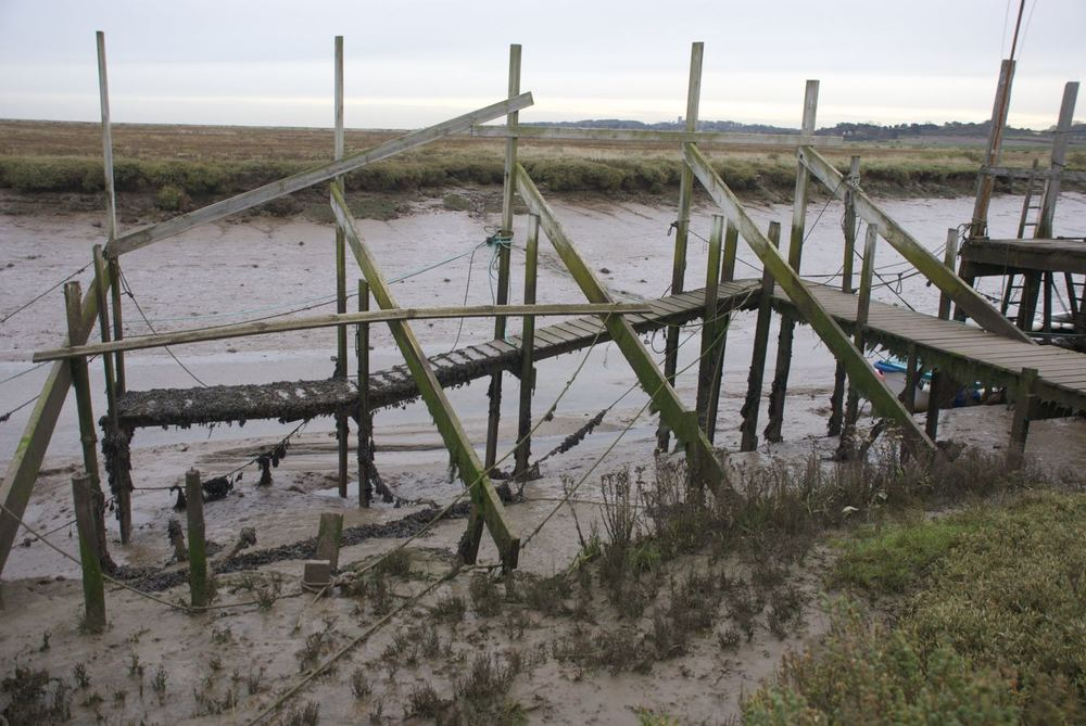 Morston.  Low tide.  One of the landing jetties for the seal trip boats.