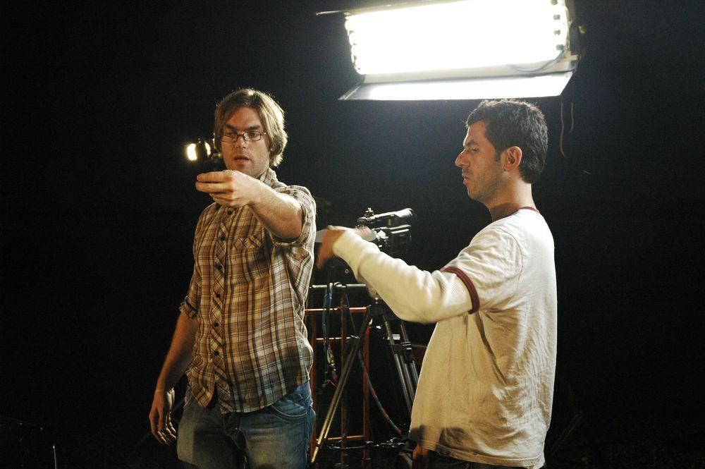 Director Ken Simpson, frames up a shot with Cinematographer Alex Dacev