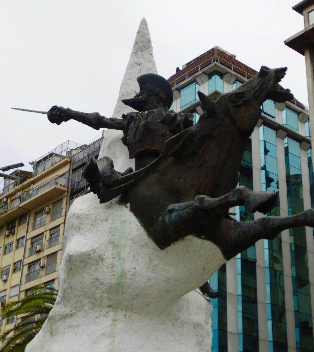"The conquistador statue, with an inscription that reads ""Desde las entranas de la pampa argentina de la tierra manchega irrumpe hacia el mundo exterior..."" meaning (as best as Google can translate): ""The entrance of the Argentine land bursts into the outside world."""