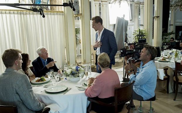 John Le CarrÈ (pointing) made a cameo in the series ñ he is in a restaurant scene that was filmed in Mallorca with Hugh Laurie, Tom Hiddleston, Tom Hollander and Elizabeth Debicki.