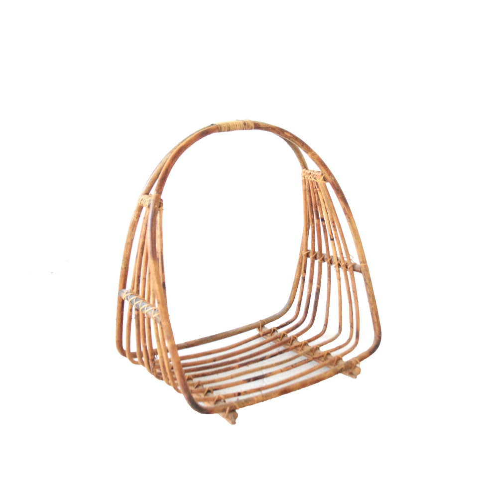 vintage bamboo and rattan firewood holder.jpg