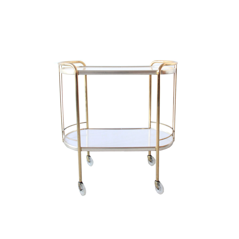 vintage mid century modern ass and white bar cart.jpg