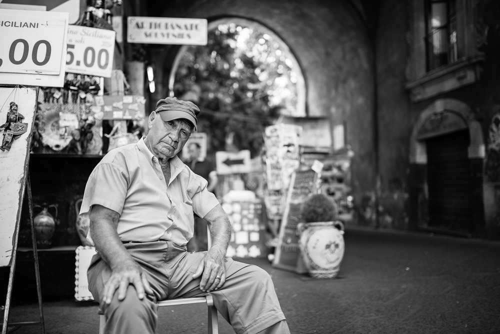 Catania local market, this man was sleeping with an eye open to check his goods