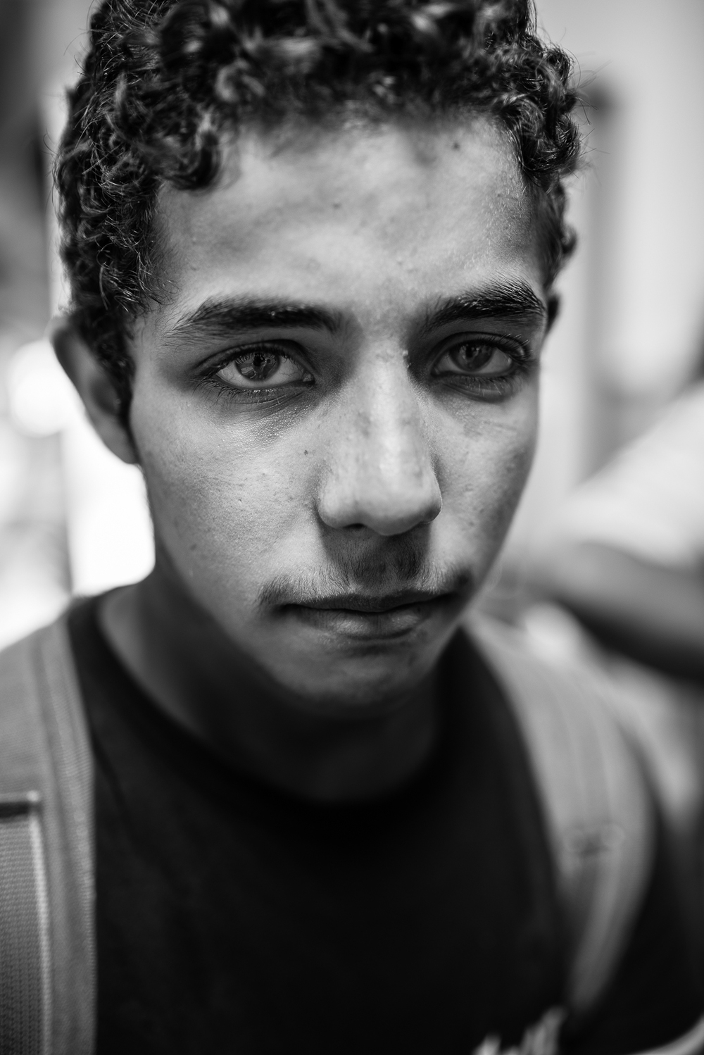 Pozzallo reception center. He is a syrian 15 years boy who has lost his family and now his alone in italy.  VIDEO/4