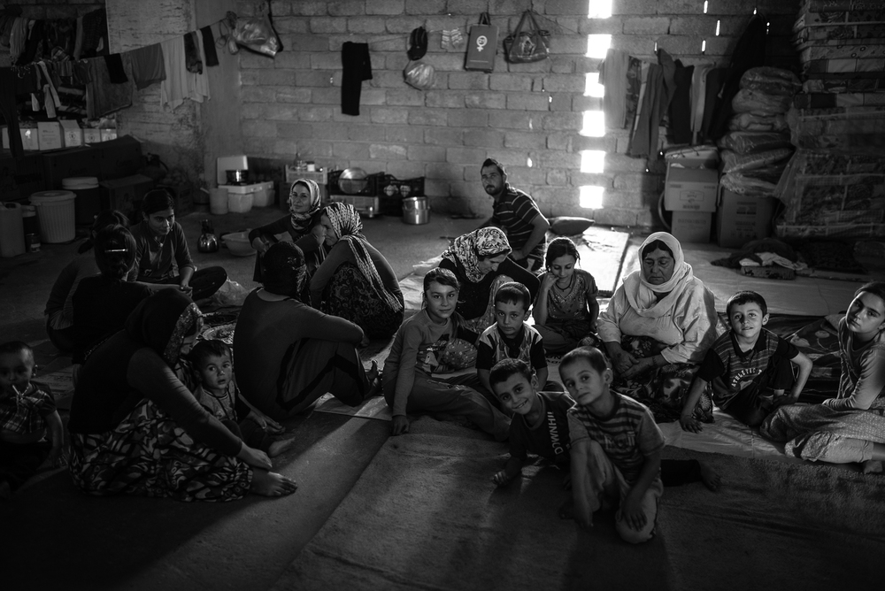 A Yazidi family inside a under construction building in Zakho