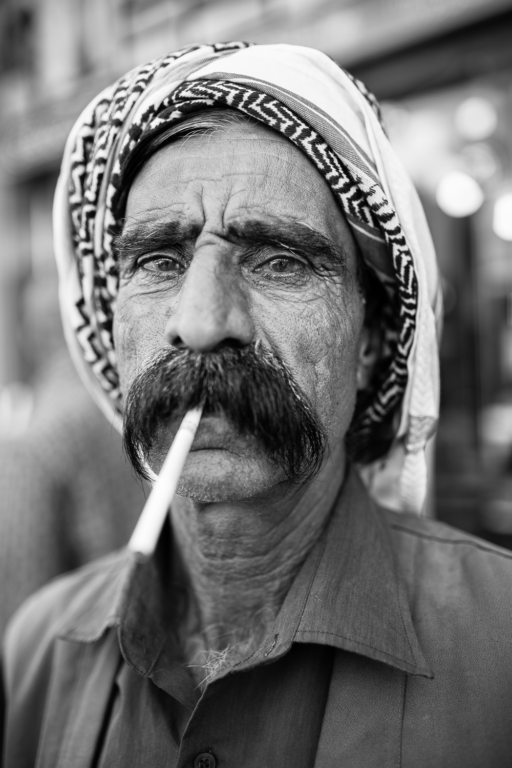 Long cigarette for long mustaches, Zakho streets.